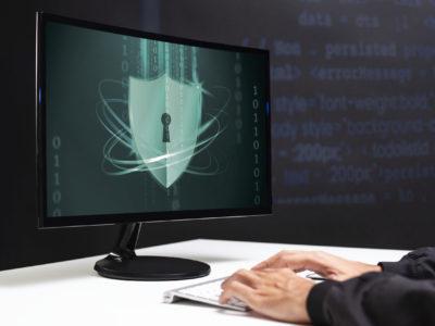 Hacker cracking the binary code data security